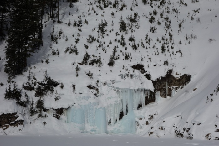 Frozen ice at the bottom of a massive old avalanche chute