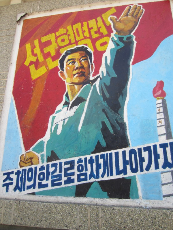 Revolutionary posters decorate the street much like billboards in other countries