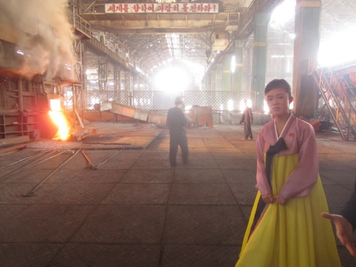 Her dress remains perfectly clean. Chollima Steel Works
