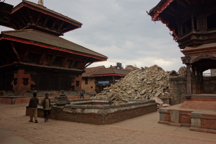 Two pagodas stand strong over a less fortunate monument