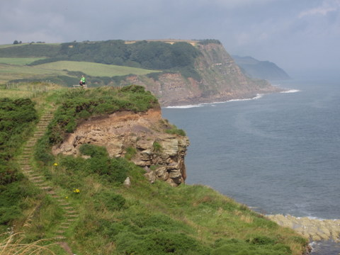 The trail meanders along sea-cliffs overlooking the choppy ocean below.