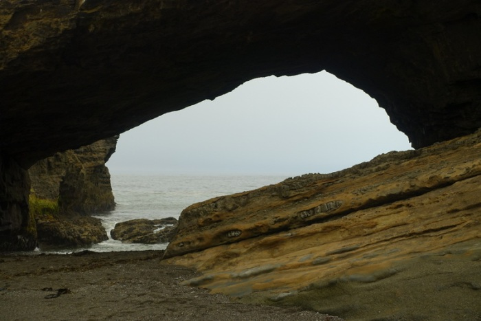 Passing through the cave at Tsusiat Point