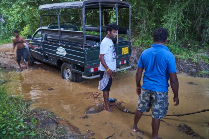Attempting to pull the jeep out of the mud using jungle vines