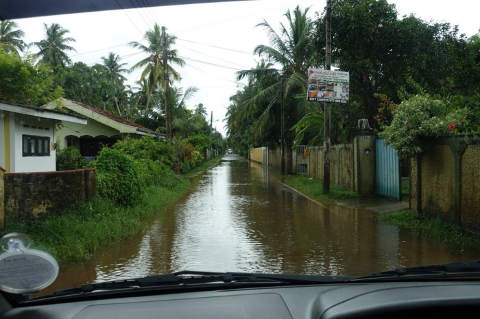 Heavy rain floods roads and houses
