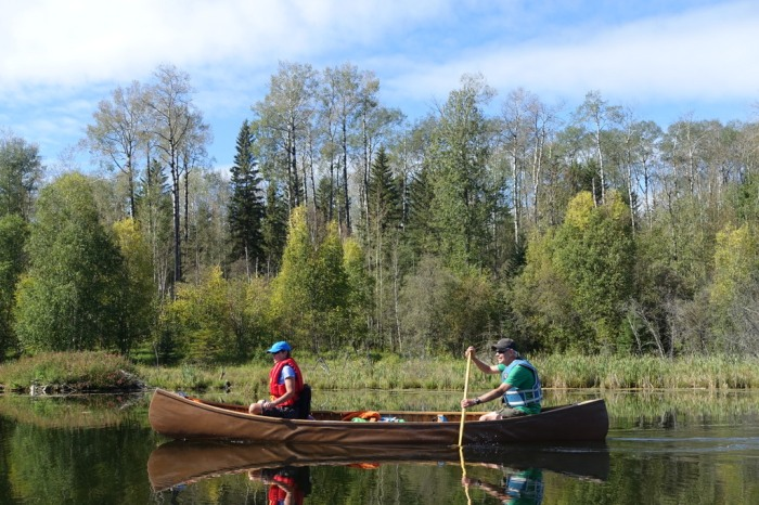 September - Canoeing peaceful lakes in Alberta