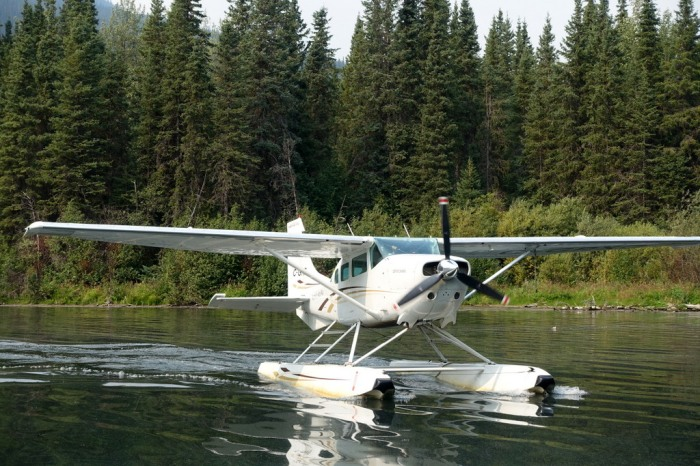 The float plane swoops in to pick us up